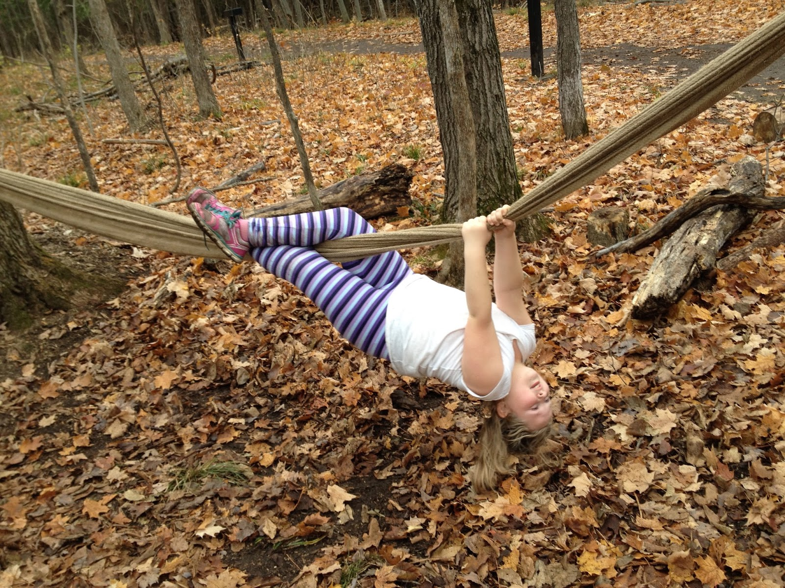 kid hanging upside down