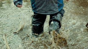 Kid playing in the rain