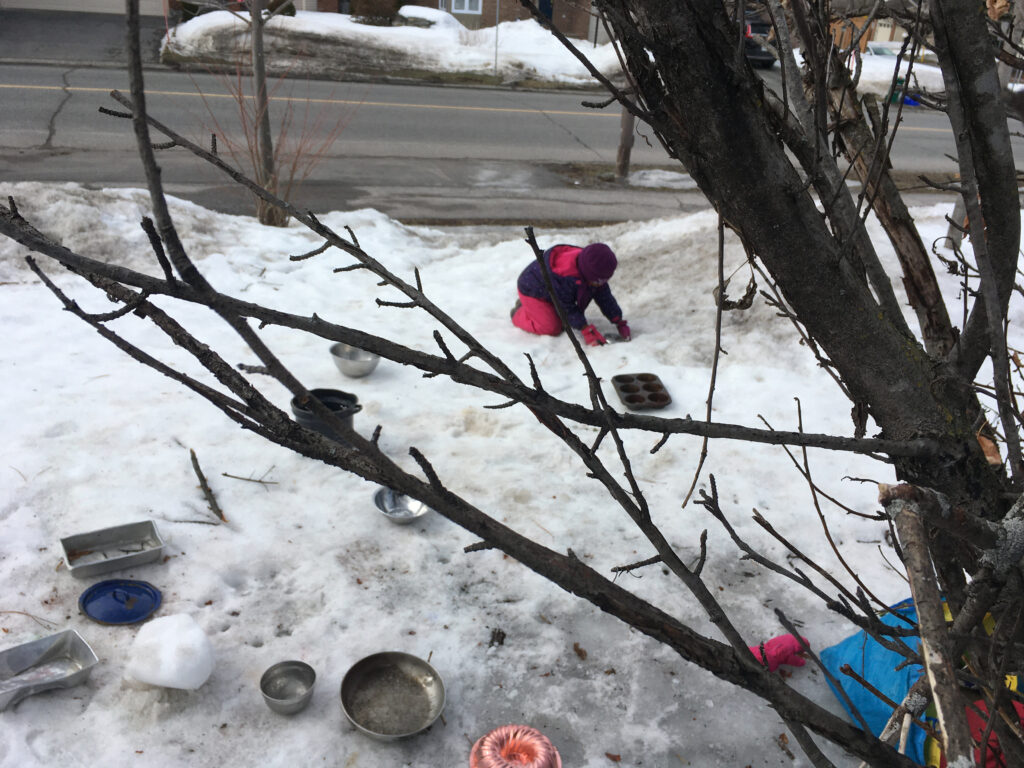 pots and pans, a girl behind a tree in the snow