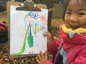 girl with drawing of flowers